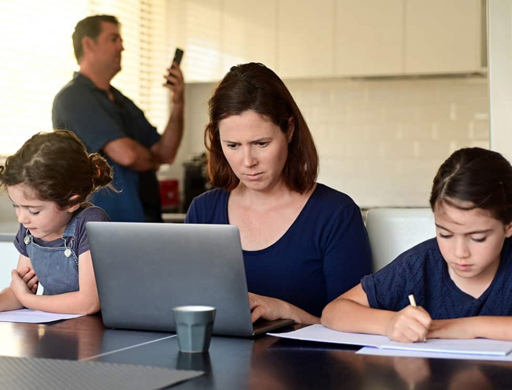 Family at home as the pandemic coronavirus (COVID-19) forces many employees and students to work and study from home. Real people. Copy space